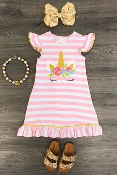 Our+unicorn+dress+is+one+of+the+cutest+dresses+we+have+seen+and+is+super+trendy!+Adorable+butter+soft+fabric.These+are+top+quality+and+true+boutique+style+dresses!+Love+these,+a+must+have!+Grab+one+now+limited+available+and+they+are+going+fast!++Includes+dress+only.
