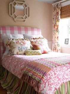 Large pattern pink gingham headboard in a girl's bedroom