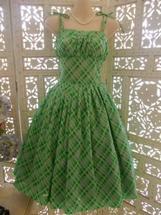 This apple green vintage light cotton fabric has been made by Red Ruby Vintage into a sundress with a gathered upper bodice top, a fitted