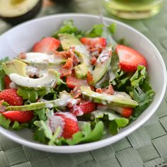 This strawberry avocado kale salad recipe is paired with a bacon poppy seed dressing. This dish is refreshing, delicious and easy to make.