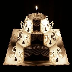 I custom made the black candles and piped melted white chocolate on parchment for the embellishments.