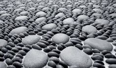 Beach stones and decorative pebbles are wonderful materials that beautify backyard landscaping ideas and create unique garden path designs
