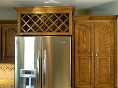 Wine rack over fridge - awesome use of space, but kinda hard to reach (and dangerous if you're short like me) :/ Tall Kitchen Cabinets, Above Cabinets, Wine Cabinets, Wine Bottle Storage, Wine Racks, Wine Bottles, Small Fridges, Wine Shelves, Under Cabinet Lighting