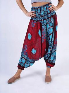 Our elephant pants you know and love, but with a twist! This new drop crotch style is lightweight with a relaxed fit. Drop crotch hammer pants in a burgundy and light blue elephant print - Two in One
