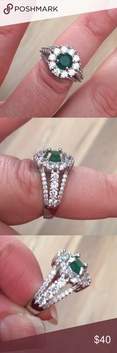 Emerald and white Sapphire ring size 7 2.5ctw Emerald and White Sapphire 14k white gold filled ring size 7. Jewelry Rings