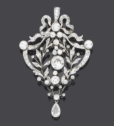 A belle époque diamond pendant, circa 1905  The openwork cartouche-shaped plaque of foliate design, surmounted by a tied ribbon bow, set throughout with rose, single and old brilliant-cut diamonds and terminating with a pear-shaped diamond swing drop, single and old brilliant-cut diamonds approx. 4.90ct. total, length 6.5cm.