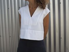 Leni Top – This boxy, cropped style features a narrow v-neck, extended sleeve and a lo...
