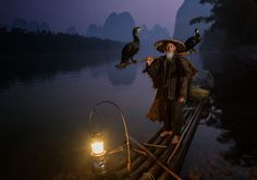 2014 Sony World Photography Awards - Cormorant fisherman just after dawn on the Li River near Xingping, Guangxi Province, China.