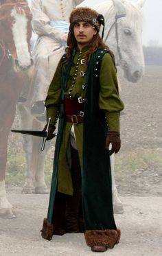 """Hungarian clothing from the turn of 15 and century. Dolman (inner coat) is made of damask and sateen. Upper coat is of velvet plus cloth and sash of velvet. Hem of upper coat and hat is decorated by fur. Medieval Fashion, Medieval Clothing, Historical Clothing, Mens Garb, European Costumes, Celtic, Landsknecht, Fantasy Dress, Medieval Fantasy"