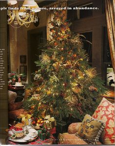 The tree is dressed with fresh fruit, dried hydrangeas, pinecones, grasses and sprigs of wheat.