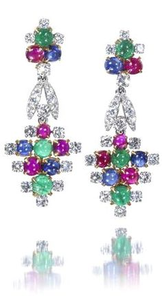 A pair of gem-set and diamond pendent earrings, by Bulgari, circa 1965 Each designed as a highly stylised fruiting vine, set throughout with cabochon rubies, emeralds and sapphires, with brilliant-cut diamond accents, diamonds approximately 3.10 carats total, one earring signed Bvlgari, length 4.5cm