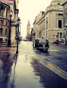 A typical London scene - black cab, red letter box and rain!