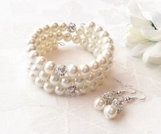 Ivory Pearl Bracelet Set Ivory Jewelry Ivory Pearl Jewelry Bridesmaid Gift Wedding by InfinityByClaire on Etsy https://www.etsy.com/listing/225658931/ivory-pearl-bracelet-set-ivory-jewelry