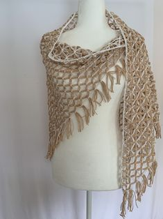 Two colors combined that match with everything. Sand is made with quality yarn, half cotton and half acrylic. Beautiful design on the neck line, Each flower sewed in by hand and the touch of white makes this shawl adequate for any occasion.Sand ⋆ Hand Made Shawl on a Triangle Loom ⋆ at SimplyNoemi ⋆