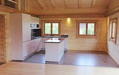 Küche in Rundholzwohnhaus
