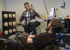 Brain-computer interface lets a man with a spinal injury feel robotic fingers