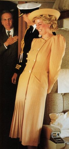 Diana.  I think this photo was taken while waiting for the plane doors to open on an Official State Visit.  Some fun before protocol