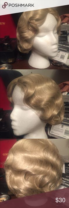 Blonde 1930s wig God condition. Super cute but I wore it for Halloween this year and don't think I'll wear it again. A high quality wig. Vintage Accessories
