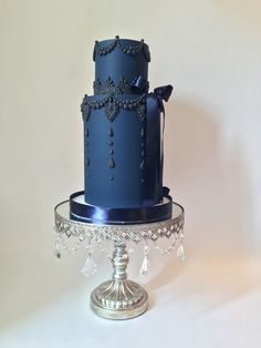 Something Blue!! Blue tiered wedding cake on antique silver chandelier cake stand created by Opulent Treasures #weddingcakes #weddingcakessilver
