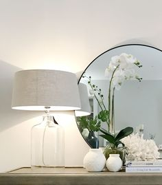 Glass lamp with soft grey shade.