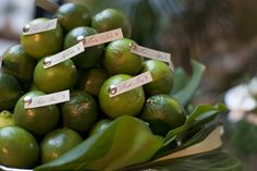 Here's a fun idea for escort cards: Debi Lilly pinned names and table numbers onto fresh limes.