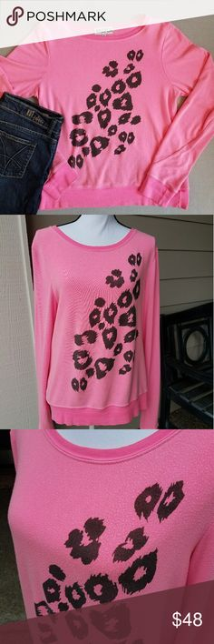 Wildfox Pink Cheeta Print Jumper SZ Small Wildfox Lightweight Sweater /Sweatshirt. If you have never worn Wildfox before this sweater runs large. It's  supposed to be a more relaxed slouchy fit. The sleeves also are a little longer than average . This has been washed and worn a handful of times - it's still in great condition. Please see close up pics - what looks like pilling is just the fabric. Purchased from Saks. Wildfox Tops