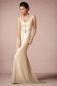 Cyprium Gown    You'll be the light of the party in this luminous Badgley Mischka exclusive, available only from BHLDN. Shimmering paillettes catch and reflect a warm rosy glow against a curve-hugging column of raw-edged chiffon with an abbreviated train, evoking the show-stopping glamour of the 30s and 40s. Back zip. Professionally clean. Imported.