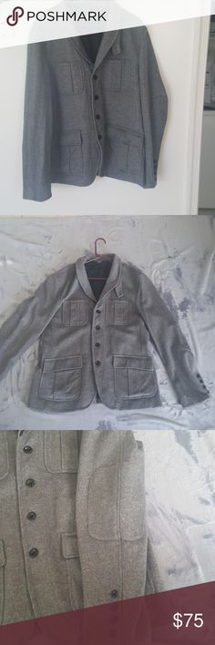 Authentic Armani Exchange Mens Coat The material is wool like material and there are no stains or marks anywhere. It has never been worn and is in great condition. It has already been washed too. 4 pockets one inside. Armani Exchange Jackets & Coats