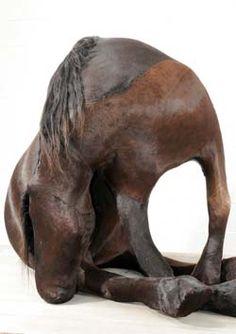 Berlinde de Bruyckere, K36 (The Black Horse), 2003, polyurethane foam, horse hide, wood, iron, 295 x 286 x 158 cm. Contemporary art, contemporary sculpture, taxidermy.