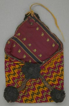 Object Name: Purse Place Made: Asia: Central Asia, Afghanistan People: Baluch Period: Mid 20th century Date: 1940 - 1950 Dimensions: L 16.5 cm x W 11 cm Materials: Cotton; metal bead Techniques: Plain woven; embroidered; beaded; pompom ID Number: T94.1153 Credit: From the Opekar / Webster Collection. Canadian Textile Museum.