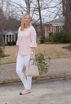 "Outfit Details: blush bell sleeve top in ""Pink Smoke"" white jeans (the best fitting jeans at a great price!) silver tassel necklace (similar) Kate Spade watch silver cuff bracelet Kate Spade handbag blush cap-toe flats Yesterday was my birthday and I wore my favorite color…blush!  When I was in my 20's, my favorite color was…"