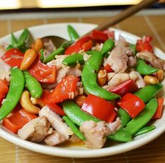 [CHICKEN STIR-FRY] :: sugar snap peas, red bell pepper, roasted cashews,minced ginger, red pepper flakes, minced garlic, cornstarch, soy sauce, Shao Hsing rice wine or dry sherry, salt, chicken broth and grapeseed, canola, peanut or vegetable oil.
