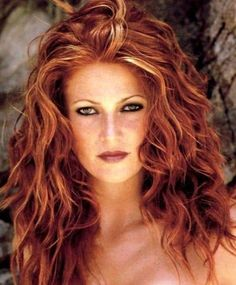Red Hair with Blonde Highlights. I wonder if my friend Lisa could help me out with this for my wedding day? I love this color and her make-up... (maybe lighter eyes?) She'd be my hero(ine)!!!