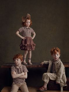 Young red-haired siblings portraits