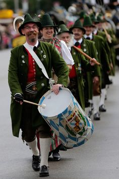 Oktoberfest 2014: Musicians in traditional costumes play during a parade in Munich.
