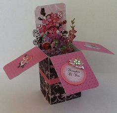 Black and pink card in a box.