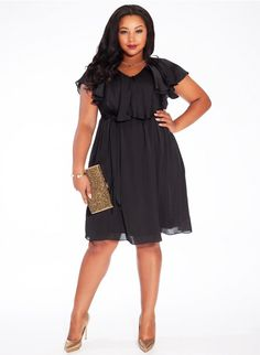 Isla Dress in Black - A chic draped ruffle flutters along the front of this v-neckline of this beautiful a-line dress. Designed with a fitted elastic waistband and included belt for feminine distinction. Soft gathers release the floaty skirt, emphasizing the flirty style. Pair with metallic accessories and a statement clutch for a go-to night look.