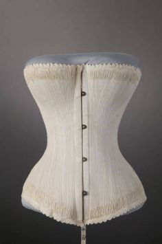 1887 cotton twill corset - really unusual, this corset is 'fully boned' like corsets leading up to the late 18th c. - in keeping with other corsets of it's period each boning channel is flossed at the top and bottom - but the profusion of boning channels creates an interesting effect with the flossing.