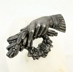 Vintage Victorian Revival Mourning Hand Brooch in Cast Pewter: The hand is holding and sheaf of English yew branches and a wreath of roses. For Victorians, yew symbolized 'sorrow' and rose symbolized 'love.'