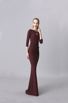 Kelcie gown: Stretch jersey gown. Plain, boat neckline with knot, cut-out detail on the top, pleats detail at waist, ¾ sleeves, mermaid silhouette. Raw edge hem...