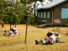 Conducting Bible studies after the Sunday meeting. Outside the Kingdom Hall in Sengerema, Tanzania.