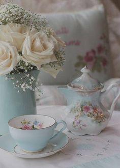 Pretty blue tea pot and cup.