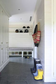 Ample built-in storage, beautiful wall paneling, love this brick pattern gray tile flooring