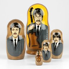 This hand-crafted nesting doll features the likeness of John Lennon, Paul McCartney, George Harrison, and Ringo Star, or as they are collectively known: The Beatles.