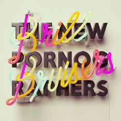 Steven Wilson and Thomas Burden's work for The New Pornographers' album, Brill Bruisers, which features CG neon lettering woven through the band's name in a bold 3D sans.
