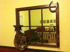 This is an antique window, painted and treated with crackle, Adding a Texas star, horse shoe, with a wagon wheel and saddle, along with a hook for that hat someday. Room has a Country/Cowboy theme. http://www.facebook.com/cgcreations1