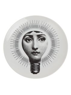 Bring distinctive design to any room of the home with this Tema e Variazioni wall plate from Fornasetti. Depicting the face of Piero Fornasetti's favourite muse, Lina Cavalieri in a lightbulb, it is b Decorative Accessories, Home Accessories, Decorative Objects, Piero Fornasetti, Fornasetti Wallpaper, Support Mural, Everyday Objects, Throw Pillow Cases, Plates On Wall