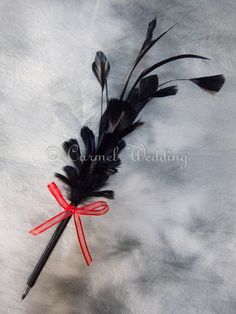 Items similar to Gothic Black Feather Pen with Red Bow - Gothic wedding pen, Gothic sign in pen, Gothic guestbook pen, Gothic welcome desk pen on Etsy Gothic Wedding, Dream Wedding, Fancy Pens, Black Feathers, Flower Crafts, Holiday Crafts, Feather Pens, Easy Crafts, Bows