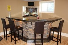 custom granite bar counter | ... stained Maple bar with Real Stone face and under counter lighting