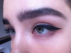 Big brows and cat-eyes.